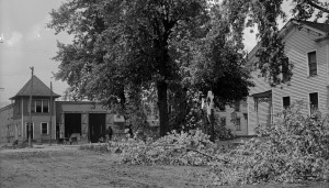 Large maple tree was snapped-off it's trunk during the 1911 storm on the SE corner of Grant and Liberty streets. The Nation House, a hotel, stood where Gant Realty stands today and the old trolley car barn across the street is where the Dollar Store and it's parking lot are today. Notice Grant street was still a dirt road.