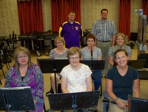Assistant director Tim Wolf, back left, with director Randy Claes, standing behind part of the Community Band's clarinet section.