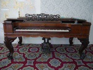 This rosewood Bradbury Square Grand Piano was likely built between 1854-1858.